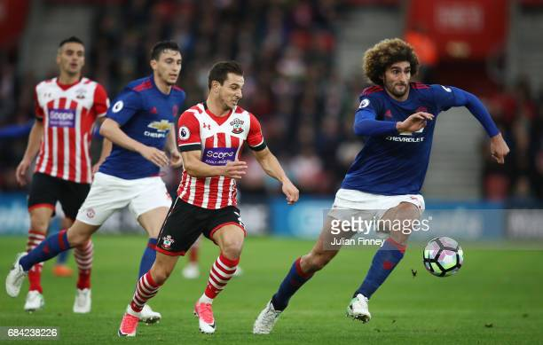 Marouane Fellaini of Manchester United and Cedric Soares of Southampton battle for possession during the Premier League match between Southampton and...