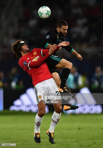 Marouane Fellaini of Manchester United and Daniel Carvajal of Real Madrid battle for possession during the UEFA Super Cup final between Real Madrid...