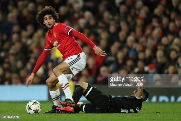 Marouane Fellaini of Manchester United and Ever Banega of Sevilla during the UEFA Champions League Round of 16 Second Leg match between Manchester...