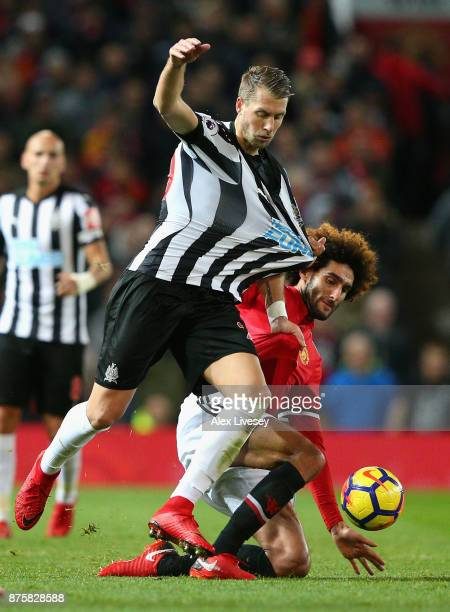 Marouane Fellaini of Manchester United and Florian Lejeune of Newcastle United in action during the Premier League match between Manchester United...