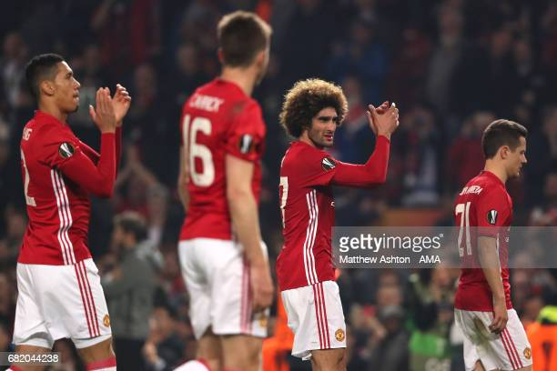 Marouane Fellaini of Manchester United and his teammates applaud the fans at the end of the UEFA Europa League semi final second leg match between...