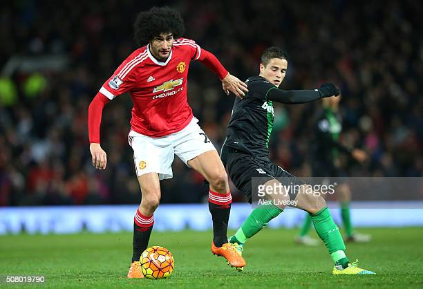Marouane Fellaini of Manchester United and Ibrahim Afellay of Stoke City compete for the ball during the Barclays Premier League match between...