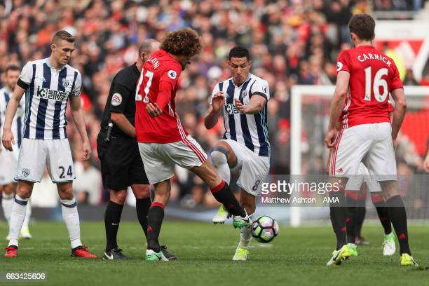 Marouane Fellaini of Manchester United and Jake Livermore of West Bromwich Albion during the Premier League match between Manchester United and West...