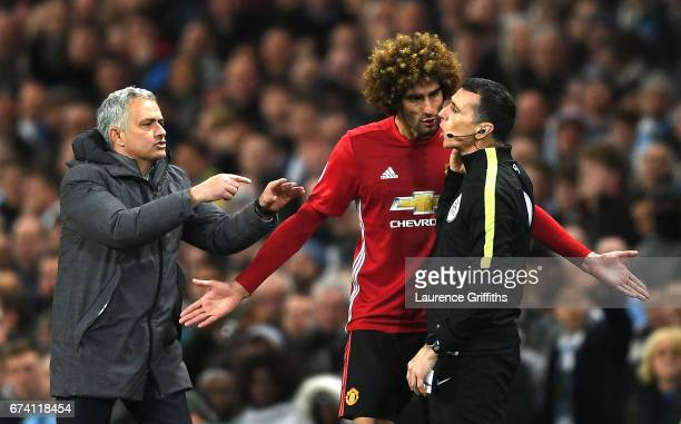 Marouane Fellaini of Manchester United and Jose Mourinho, Manager of Manchester United protest to the 4th official following his sending off during...