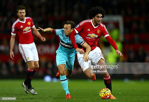 Marouane Fellaini of Manchester United and Mark Noble of West Ham United compete for the ball during the Barclays Premier League match between...