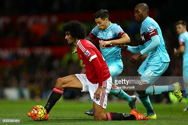 Marouane Fellaini of Manchester United and Mauro Zarate of West Ham United compete for the ball during the Barclays Premier League match between...