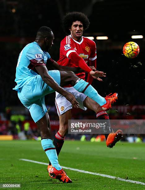 Marouane Fellaini of Manchester United and Michail Antonio of West Ham United compete for the ball during the Barclays Premier League match between...