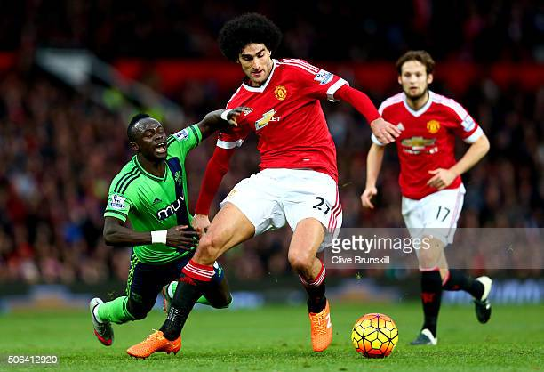 Marouane Fellaini of Manchester United and Sadio Mane of Southampton compete for the ball during the Barclays Premier League match between Manchester...