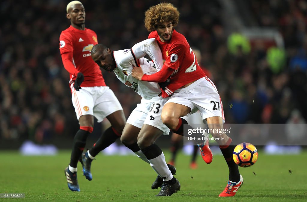 Marouane Fellaini of Manchester United and Stefano Okaka of Watford compete for the ball during the Premier League match between Manchester United and Watford at Old Trafford on February 11, 2017 in Manchester, England.