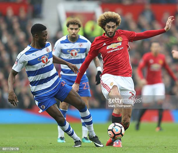 Marouane Fellaini of Manchester United and Tyler Blackett of Reading compete for the ball during the Emirates FA Cup third round match between...