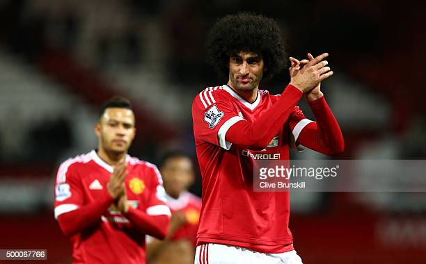Marouane Fellaini of Manchester United applauds supporters after the Barclays Premier League match between Manchester United and West Ham United at...
