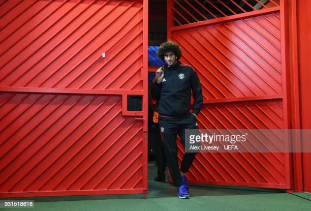 Marouane Fellaini of Manchester United arrives at Old Trafford prior to the UEFA Champions League Round of 16 Second Leg match between Manchester...