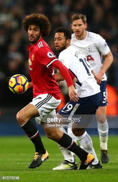 Marouane Fellaini of Manchester United battles for possesion with Mousa Dembele of Tottenham Hotspur during the Premier League match between...