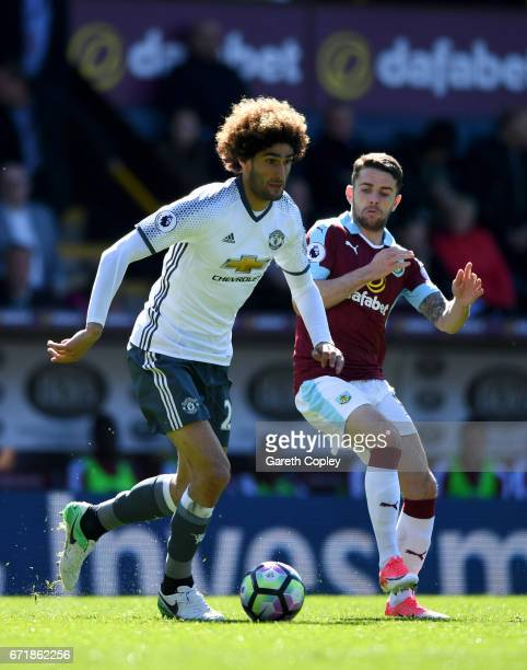 Marouane Fellaini of Manchester United battles for the ball with Robbie Brady of Burnley during the Premier League match between Burnley and...