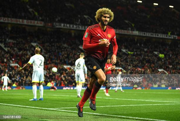 Marouane Fellaini of Manchester United celebrates after scoring his team's second goal during the Carabao Cup Third Round match between Manchester...