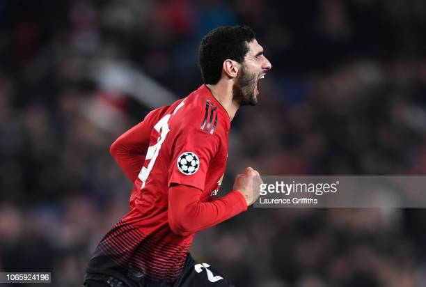 Marouane Fellaini of Manchester United celebrates after scoring his team's first goal during the UEFA Champions League Group H match between...