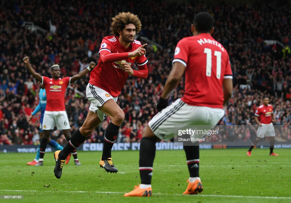 Marouane Fellaini of Manchester United celebrates after scoring his sides second goal during the Premier League match between Manchester United and Arsenal at Old Trafford on April 29, 2018 in Manchester, England.