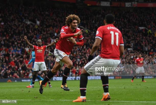Marouane Fellaini of Manchester United celebrates after scoring his sides second goal during the Premier League match between Manchester United and...