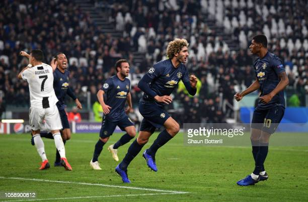 Marouane Fellaini of Manchester United celebrates his sides second goal which came through a Alex Sandro of Juventus own goal during the UEFA...