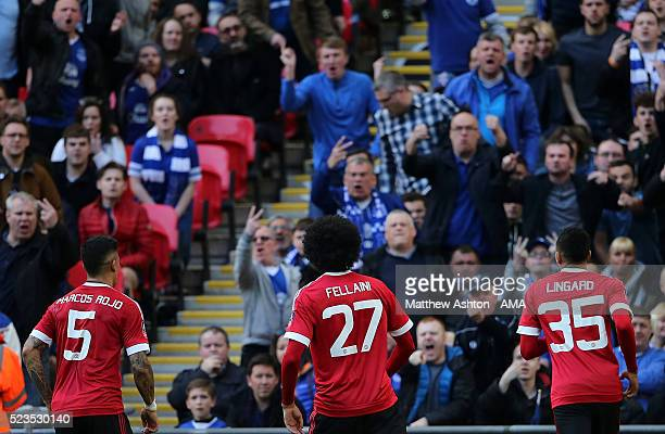 Marouane Fellaini of Manchester United celebrates scoring a goal to make the score 01 in front of the Everton fans during the Emirates FA Cup Semi...