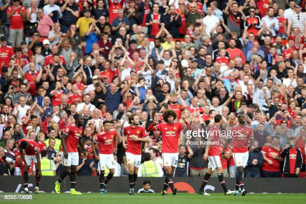 Marouane Fellaini of Manchester United celebrates scoring his sides second goal with his Manchester United team mates during the Premier League match...