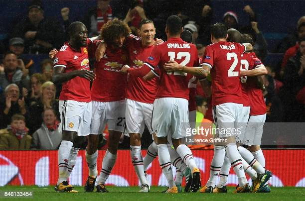 Marouane Fellaini of Manchester United celebrates scoring his sides first goal with his Manchester United team mates during the UEFA Champions League...