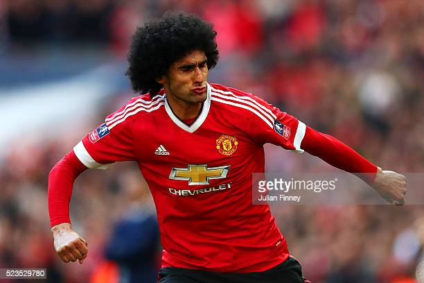 Marouane Fellaini of Manchester United celebrates scoring the opening goal during The Emirates FA Cup semi final match between Everton and Manchester...