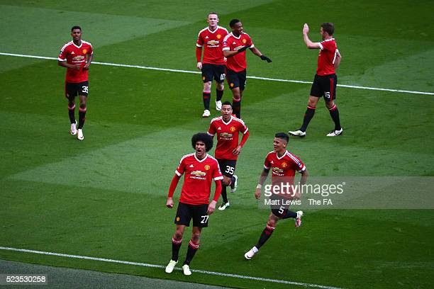 Marouane Fellaini of Manchester United celebrates scoring the opening goal with team mates during the Emirates FA Cup Semi Final match between...