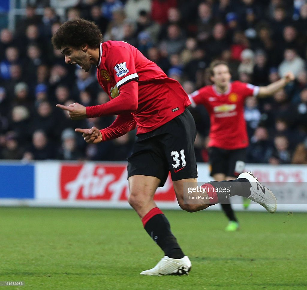 Marouane Fellaini of Manchester United celebrates scoring their first goal during the Barclays Premier League match between Queens Park Rangers and Manchester United at Loftus Road on January 17, 2015 in London, England.