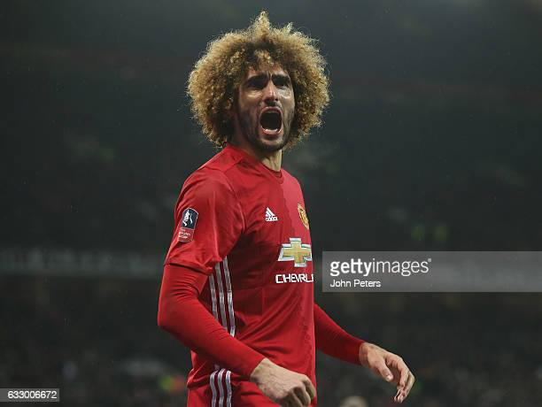 Marouane Fellaini of Manchester United celebrates scoring their first goal during the Emirates FA Cup Fourth Round match between Manchester United...