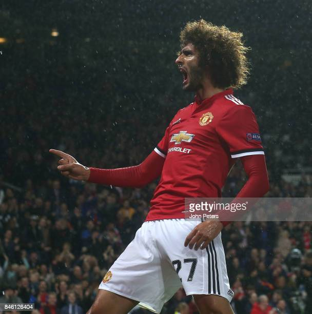 Marouane Fellaini of Manchester United celebrates scoring their first goal during the UEFA Champions League group A match between Manchester United...