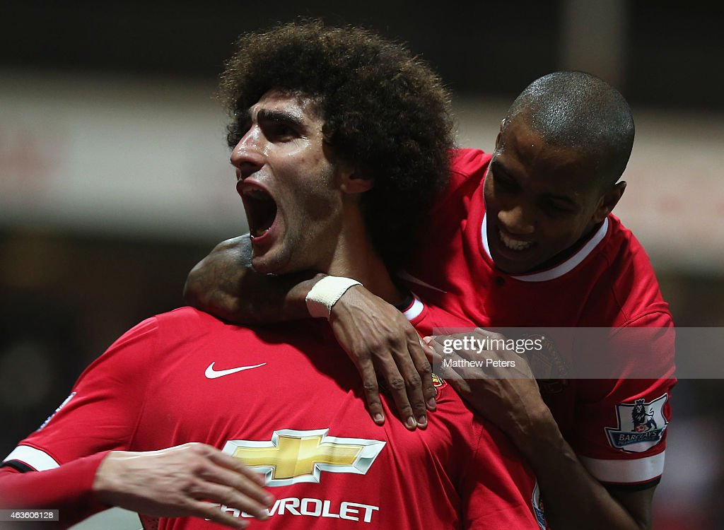 Marouane Fellaini of Manchester United celebrates scoring their second goal during the FA Cup Fifth Round match between Preston North End and Manchester United at Deepdale on February 16, 2015 in Preston, England.
