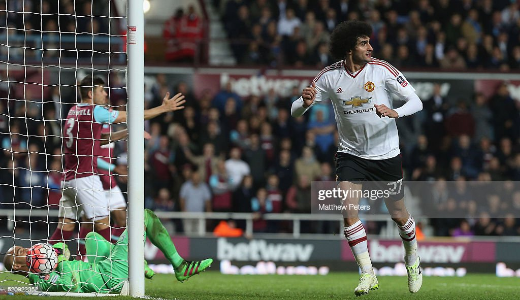 Marouane Fellaini of Manchester United celebrates scoring their second goal during the Emirates FA Cup Sixth Round replay match between West Ham United and Manchester United at Boleyn Ground on April 13, 2016 in London, England.