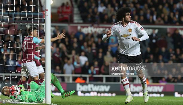 Marouane Fellaini of Manchester United celebrates scoring their second goal during the Emirates FA Cup Sixth Round replay match between West Ham...