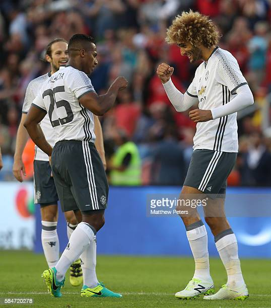 Marouane Fellaini of Manchester United celebrates scoring their fourth goal during the preseason friendly match between Manchester United and...