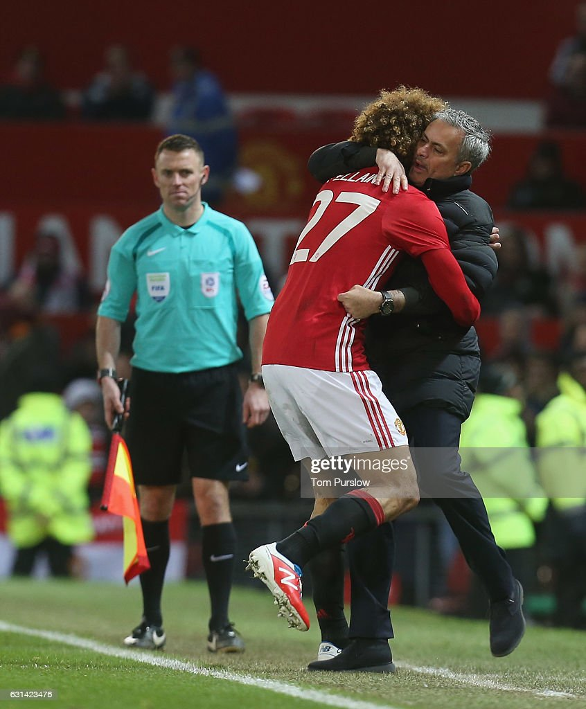 Marouane Fellaini of Manchester United celebrates scoring their second goal with Manager Jose Mourinho during the EFL Cup Semi-FInal first leg match between Manchester United and Hull City at Old Trafford on January 10, 2017 in Manchester, England.