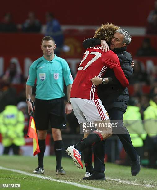 Marouane Fellaini of Manchester United celebrates scoring their second goal with Manager Jose Mourinho during the EFL Cup SemiFInal first leg match...
