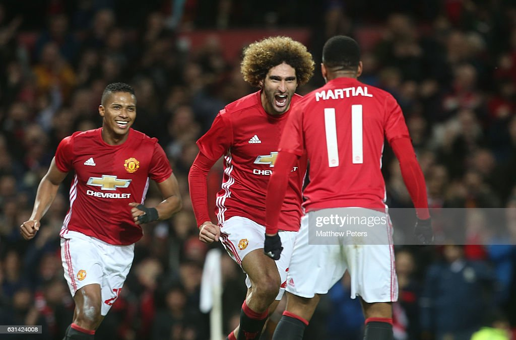 Marouane Fellaini of Manchester United celebrates scoring their second goal during the EFL Cup Semi-Final first leg match between Manchester United and Hull City at Old Trafford on January 10, 2017 in Manchester, England.