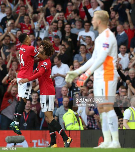 Marouane Fellaini of Manchester United celebrates scoring their second goal during the Premier League match between Manchester United and Leicester...