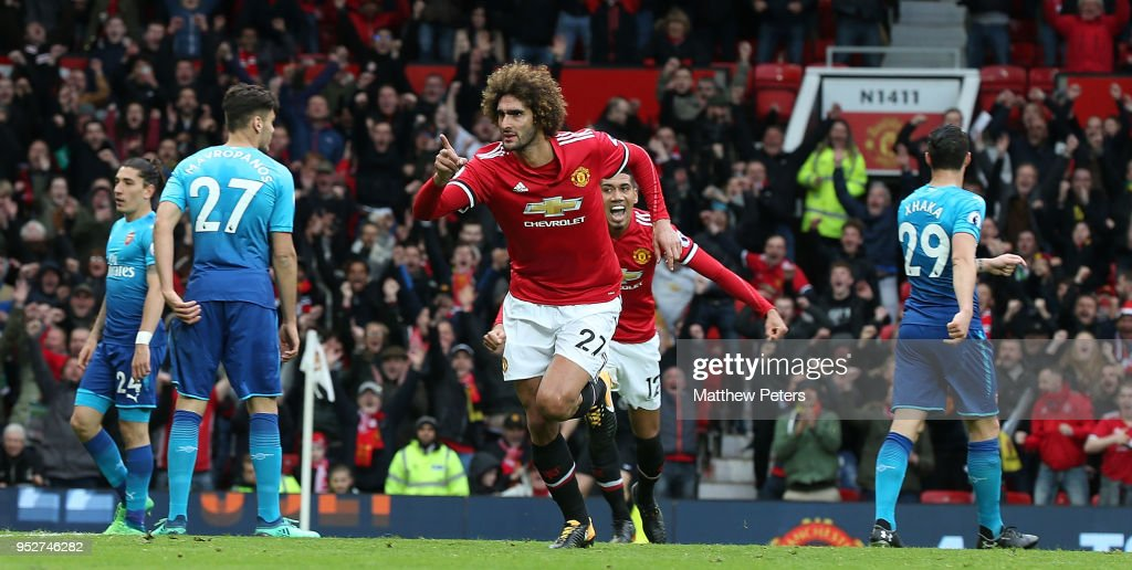 Marouane Fellaini of Manchester United celebrates scoring their second goal during the Premier League match between Manchester United and Arsenal at Old Trafford on April 29, 2018 in Manchester, England.
