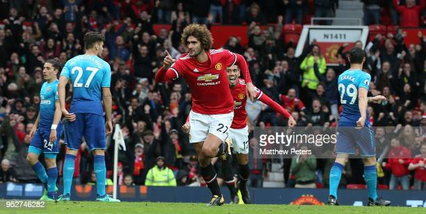 Marouane Fellaini of Manchester United celebrates scoring their second goal during the Premier League match between Manchester United and Arsenal at...