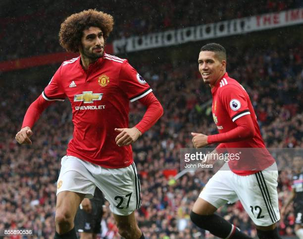 Marouane Fellaini of Manchester United celebrates scoring their third goal during the Premier League match between Manchester United and Crystal...