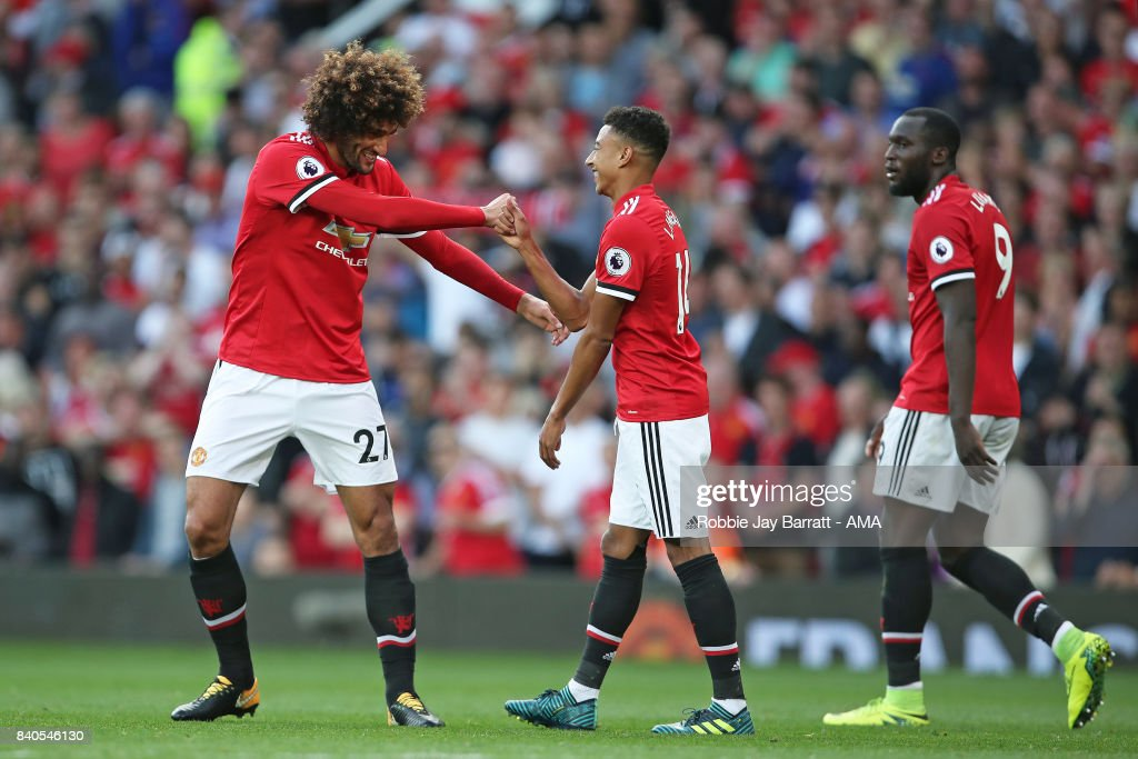 Marouane Fellaini of Manchester United celebrates with Jesse Lingard of Manchester United after he scores a goal to make it 2-0 during the Premier League match between Manchester United and Leicester City at Old Trafford on August 26, 2017 in Manchester, England.