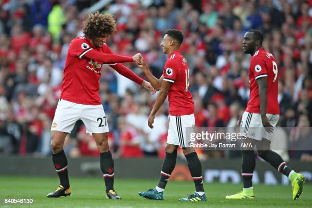 Marouane Fellaini of Manchester United celebrates with Jesse Lingard of Manchester United after he scores a goal to make it 20 during the Premier...