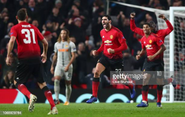 Marouane Fellaini of Manchester United celebrates with team mates Marcus Rashford and Romelu Lukaku after scoring his team's first goal during the...