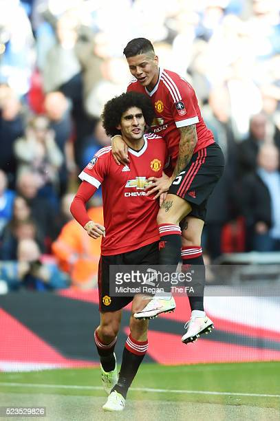 Marouane Fellaini of Manchester United celebrates with teammate Marcos Rojo after scoring the opening goal during the Emirates FA Cup Semi Final...