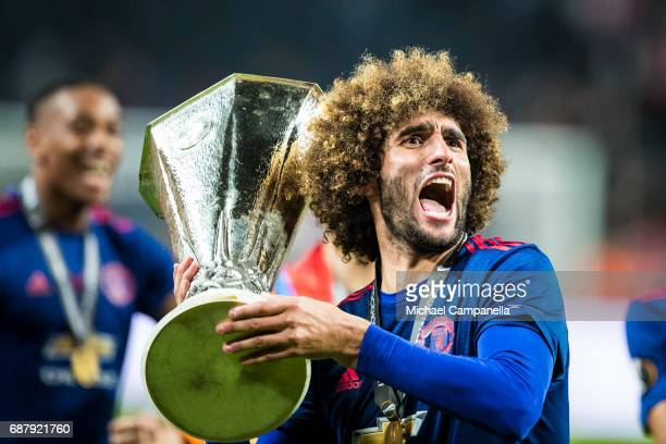 Marouane Fellaini of Manchester United celebrates with the Europa League trophy after the UEFA Europa League final between Ajax and Manchester United...