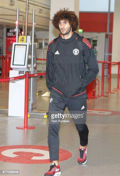 Marouane Fellaini of Manchester United checks in ahead of their flight to Basel at Manchester Airport on November 21 2017 in Manchester England