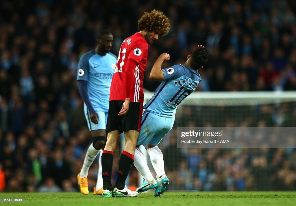 Marouane Fellaini of Manchester United clashes heads with Sergio Aguero of Manchester City during the Premier League match between Manchester City and Manchester United at Etihad Stadium on April 27, 2017 in Manchester, England.