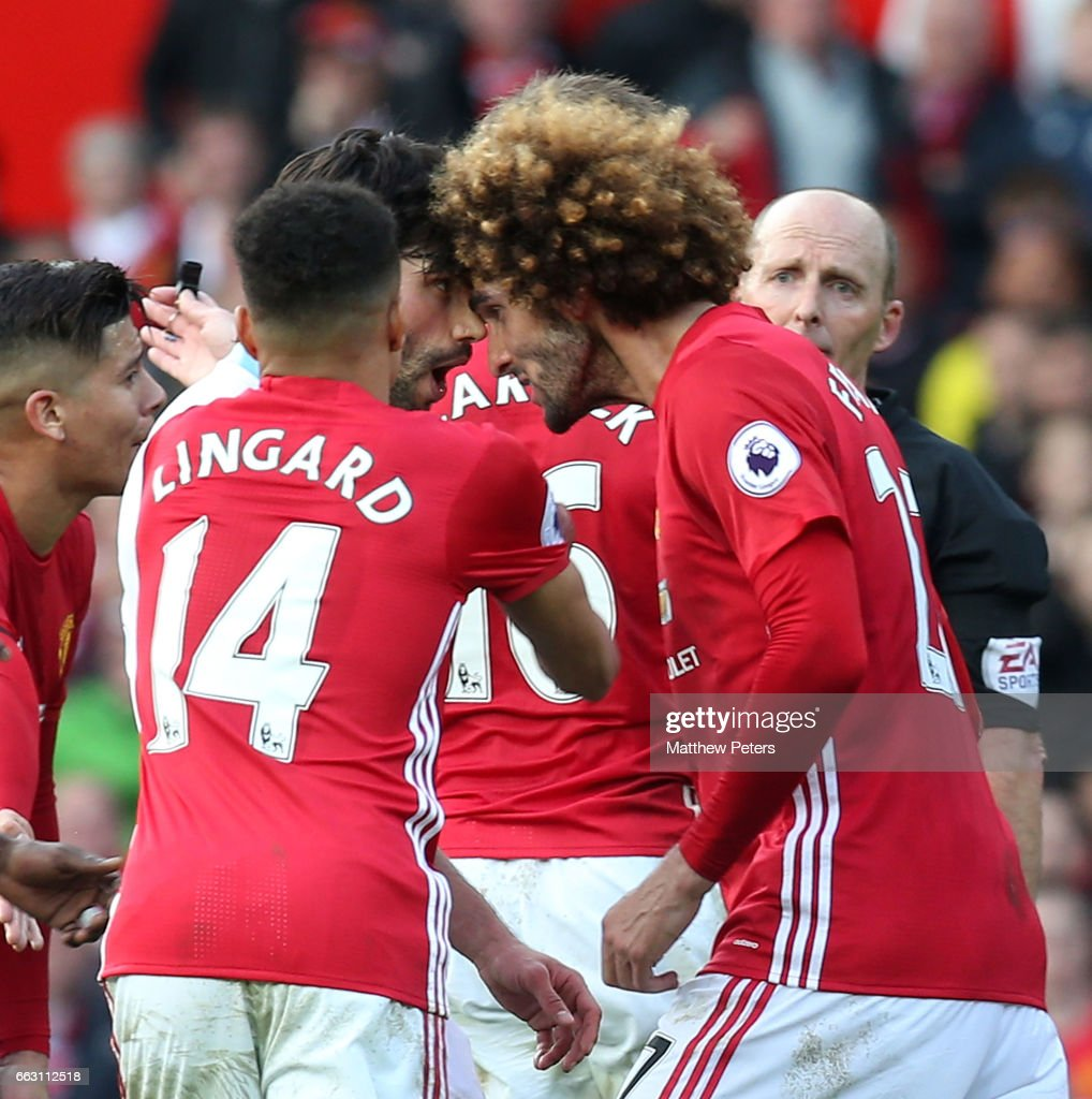 Marouane Fellaini of Manchester United clashes with Claudio Yacob of West Bromwich Albion during the Premier League match between Manchester United and West Bromwich Albion at Old Trafford on April 1, 2017 in Manchester, England.